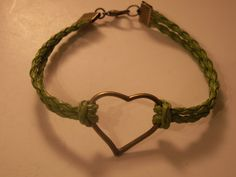 Green faux leather bracelet, with bronze ton accents.