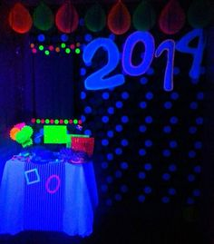 Neon New Years Black light party... Glowing, glow in the dark and uv reactive photo booth