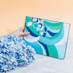 Add a pop of color to any look with this iconic masterpiece of a bag by Pucci. ‪#‎MarchToSummer‬ ‪#‎RustansColorAndPetals‬