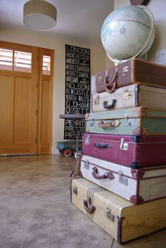 I love the suitcases and the city wall hanging