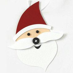 Design by Vicki Boutin Brads are a great option for Santa's eyes. Give his mustache dimension with adhesive foam, and add a cute button nose.  SOURCES: Cardstock: Bazzill Basics Paper. Brads: Making Memories. Button: Autumn Leaves. Cutting tool: Fiskars./