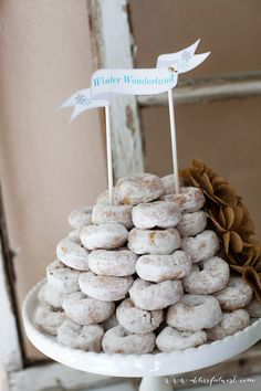 Donut tower for a Winter Wonderland Party. Simple and so easy! #winterwonderland #christmasparty