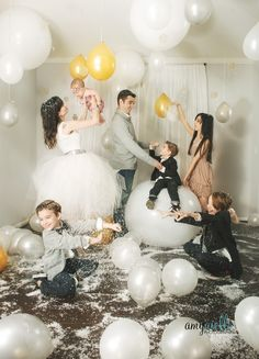 indoor holiday family photo fake snow balloons tinsel and glitter   http://blog.amyphotochicago.com/