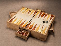 The Dome is a backgammon made by Wood and Mood, inspiring by modern stadiums and using traditional woods like Walnut, Mahogany, Beech and Maple .This board game is particular for its drawers: two give the possibility to launch dices inside them, and the others contain pieces.It is possible to realize the Chess or Checkers version.