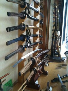 """Japanese Swords - photo by Steve Nagata: In Kudanshita now, just north of the Imperial Palace and saw this shop selling Japanese swords. Most of these swords are purely decorative or are for use in practicing a martial art known as Iaidou 居合道 so they do not have sharpened blades. It is now illegal to carry a sword around with you in Japan, but centuries ago the upper classes in Japan would always carry the """"two swords""""."""