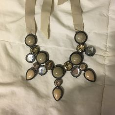 jeweled necklace *worn once* beige and silver jewels; tied around neck by ribbon Jewelry Necklaces