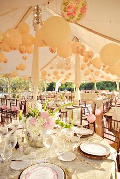 Lanterns galore from the ceiling to the seats bring a touch of whimsy to the classic look and pops of fuschia just make everyone smile, right?