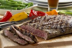 We combined two of Dad's favorites to come up with this recipe for Dad's Beer Marinated Steak. It's our outrageous marinade that makes this flank steak so mouthwatering and rich-tasting. Make this for him on Father's Day or any day and you'll definit Beer Steak Marinade, Marinated Steak, Steak Marinades, Steak Recipes, Grilling Recipes, Cooking Recipes, Game Recipes, Kitchen Recipes, Kitchens