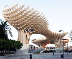 Metropol Parasol Seville, Spain, the undulating parasols of interlocking wooden panels are the world's largest wooden structure
