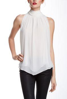 Love this flowy white sleeveless blouse.