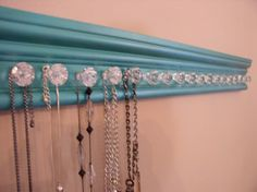 WOW jewelry/ necklace holder with 18 decorative small acrylic knobs with teal metallic finish 25 inches. $44.00, via Etsy.