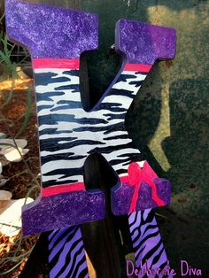 Large letter K bow holder with zebra print, sparkly purple and pink bow accents. for sale on etsy