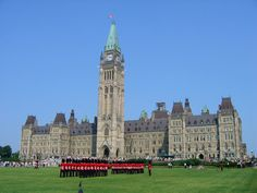 The daily changing of the guard at Parliament in Ottawa. They show a history of Canada movie on the entire building in the spring and summer.