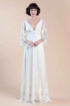 With a romantic plunging neckline. | 36 Of The Most Effortlessly Beautiful Boho Wedding Dresses Ever