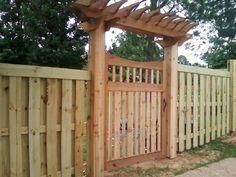 shadow box fence with top trim with designer walk gate and top 'bridge'