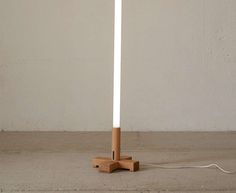 neon-tube-light-wood-stand-urbanoutfitters-remodelista