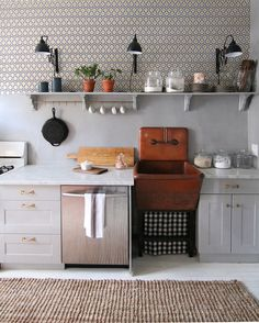 Sometimes the best design ideas come in the smallest of packages. And for me, that tiny design wonder is Megan Pflug's incredible antique sink. She unveiled her mini kitchen makeover earlier this year