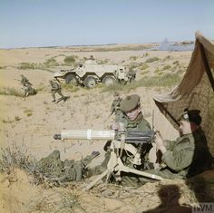British; Royal Scots, 1st Battalion, Libya, April, 1963. A medium machine gun team providing cover while men of the 1st Battalion, The Royal Scots disperse from a Saracen Armoured Personnel Carrier to take up attacking positions in the Libyan Desert, during an exercise. Armoured Personnel Carrier, British Armed Forces, Royal Marines, British Army, Dieselpunk, Military History, World War, Soldiers, Ww2