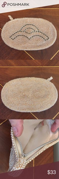 """Vintage Pearl  Beaded Clutch / Makeup Bag Vintage Pearl & Beaded Bag. I have owned this since I could remember. Made in Japan. Clean inside. Used as an evening bag by me (does not fit a IPhone 6) you could use as a holder for lipstick. Etc. the little Beaded tab needs to be glued back on. All beads and pearls are on Bag. Tab missing few beads. But a pain in tail when on honestly. Will be in Bag when shipped. On for photos! Measurements appropriately 7""""L x 4""""D please ask all questions prior…"""