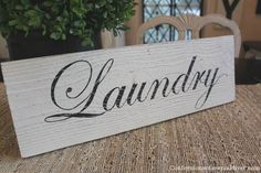 Laundry sign from an old fence picket