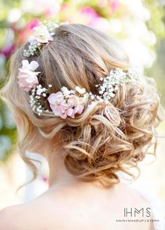 Wispy locks and a gorgeous flower crown make for for an incredibly romantic wedding day hairstyle. Hair and Makeup by Steph