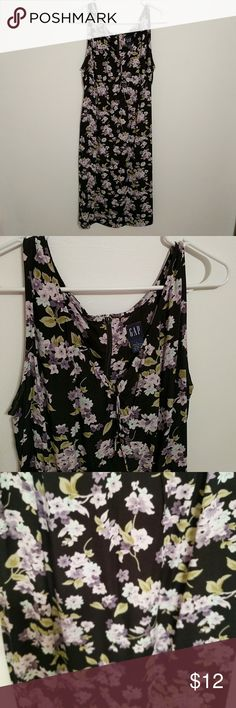 Gap floral dress The colors in this dress are black, pale green, Paola Van Der, and pale blue. It is made of 100% rayon GAP Dresses