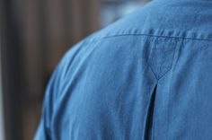 MD showing the inverted pleat back detail on a Cleeve of London for Drake's denim shirt.
