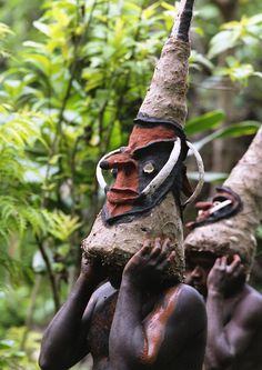 Men wearing circumcision masks, Melekula island, Vanuatu   •   Melekula (Mallicolo ) circumcision masks, they have a double face: on in front , one in the back.  Boys are circumcised at 13.
