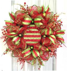 How to Attach Large Decorative Ornaments to Deco Mesh Wreaths by Julie Siomacco of Southern Charm Wreaths http://southerncharmwreaths.com/blog/attaching-large-ornaments-to-deco-mesh-wreaths/