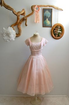 Oh I need this dress and a tea party.