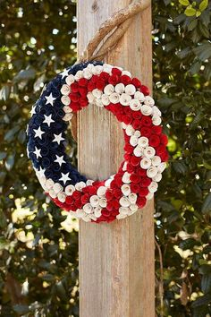 With more than a little patriotic panache pier patriotic wood curl wreath is handcrafted from natural poplar wood rosettes painted red white and blue then adorned with glittering white stars consider it an all american salute for your front door or bac Patriotic Wreath, Patriotic Crafts, Patriotic Decorations, July Crafts, 4th Of July Wreath, Americana Crafts, Flag Wreath, Holiday Wreaths, Holiday Fun