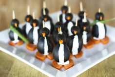 Adorable appetizer penguins. Made with black olives, cream cheese, and carrots.