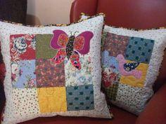 Almofada em patchwork com aplicação: borboleta, flores, pássaros