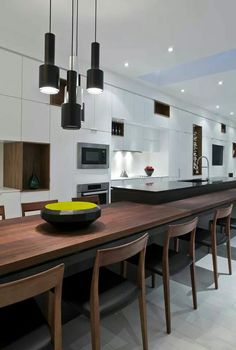 Beautiful walnut dining table and chairs designed by Ciccone Simone in Toronto