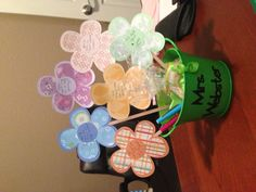 """Paper Flower Arrangement for teacher appreciation. The center of the flowers say """"Please don't cry as we say goodbye. (Initialed tissues attached) We'd like to express our """"app""""reciation (iTunes, amazon, google play, etc. gift card) because you have been a """"scent""""sational teacher. (Scentsy bar) You have shown me all the """"write"""" steps, (sticky notes and pens) and helped make me one smart cookie. (Cookies) We love you!"""