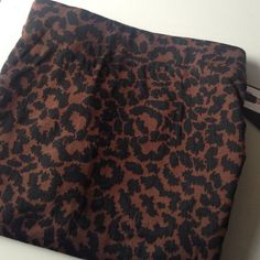 Leopard print skirt NWT Black and Brown pencil skirt. Never worn and in brand new condition. Nicole Miller Skirts Pencil