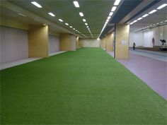 Indoor sports can still have an outdoor feel by installing artificial grass on the court or pitch.