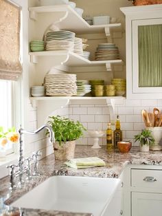 white subway tile backsplash with white open shelves, farm sink and granite countertops.  Beautiful. Except I know from experience that those things will get a disgusting film on them from being out in the open if they aren't being used and washed ALL THE TIME. Sigh