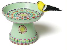 A bird bath using clay pots, paint and markers.