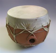Native American style water drum for ceremonial use.  Earthenware, goat skin, height 24 cm, head diameter 20 cm.