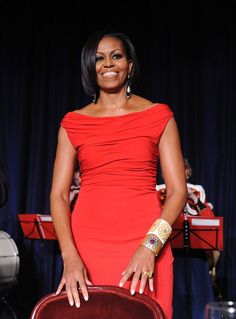 Pin for Later: See Every Dress Michelle Obama Wore For the White House Correspondents' Dinners 2010: Prabal Gurung Michelle selected an off-the-shoulder Prabal Gurung design with slight ruching. She added embellished bangles and gorgeous drop earrings.