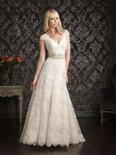 Style# 9016 Visit Vera's House of Bridal in Madison, Wisconsin to try on this and similar dresses today! For specific dresses please call ahead, as our inventory changes daily!