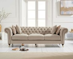 Holbrook Chesterfield 3 Seater Sofa In Beige Linen With Wooden Legs, features a classic and cosy design which is sure to make an impression in any living room setting. Upholstered in Beige Linen wi. Beige Sofa Living Room, Chesterfield Living Room, Living Room Sofa Design, Home Room Design, Living Room Designs, Fabric Chesterfield Sofa, Beige Couch, Sofa Furniture, Living Room Furniture