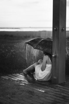 Black and White photography girl with umbrella rain crops country pole