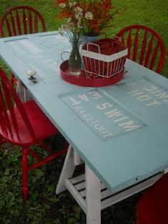 Outdoor Table made from an old door.  Love the subway art words on the table top.  Creator included summer words:  Ice Cream, Love, Friends, Relax, Sunshine, Family, Fun, Lemonade, Hamburger, Eat, Swim, Barefoot, Hot, Picnic, Laugh