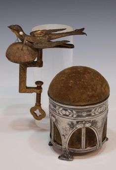 Victorian Sewing Bird and Silver Pin Cushion.