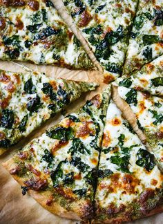 Kale pesto pizza with crispy kale on top! This is a simple weeknight pizza for kale lovers. cookieandkate.com