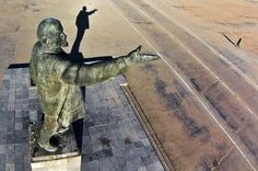 A woman walks past a statue of Soviet Union founder Vladimir Lenin at the Russian-leased Baikonur Cosmodrome, in Kazakhstan, on October 31, 2017
