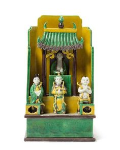 A Chinese Famille Verte Biscuit Porcelain Figural Group  KANGXI PERIOD  modeled as a shrine with attendants standing on a balcony beneath an overhanging roof.  Height 9 3/4 inches.
