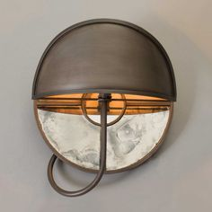 The Urban Electric Company's Girandole Sconce- shown in Blackened Pewter, Left.